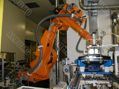Orange robot standby for next work process.