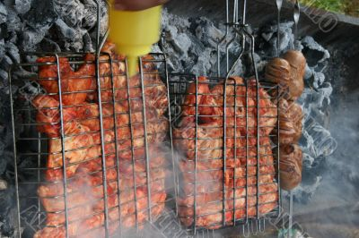 Preparing meat barbecue upon open fire