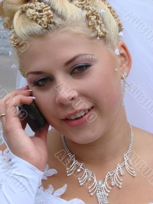 Young bride with cell phone
