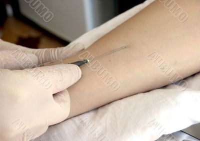 nurse hand with syringe doing injection