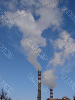 cloudscape with smoking industrial pipes