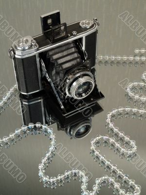 Old camera with jewelry