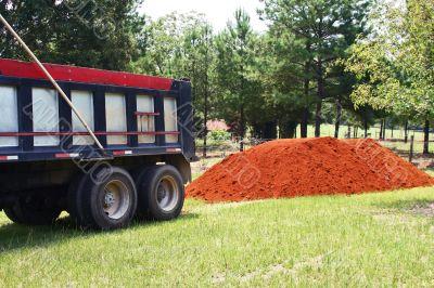 Dump Truck and Dirt Pile