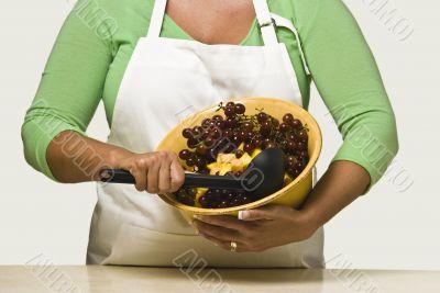 Woman Cook Mixing Fruit