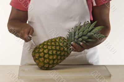 Woman Cutting Pineapple