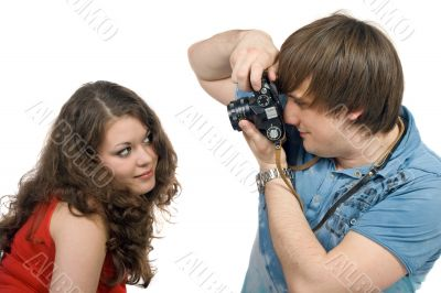 Photographer taking pictures of the young woman