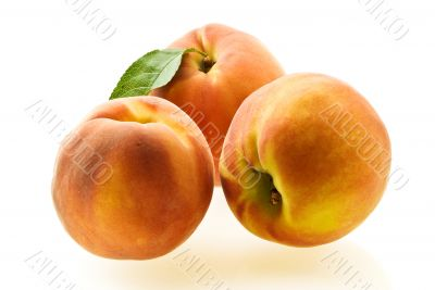 three ripe fresh peaches