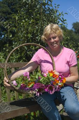 elderly woman just picked a bunch of flowers