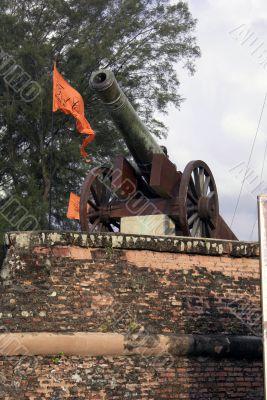Wall, flag and gun