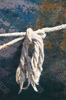Detail of frayed rope on side of boat