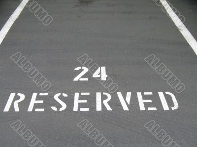reserved sign on the asphalt