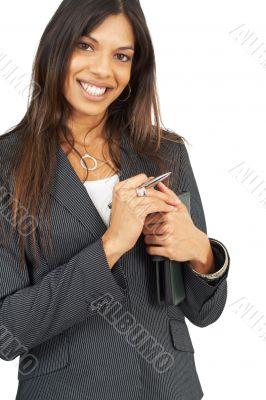 Beautiful brunette woman holding a daybook