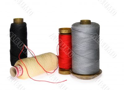 Reels of thread and needle