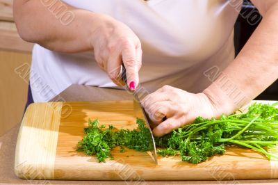 Woman chopping food in kitchen