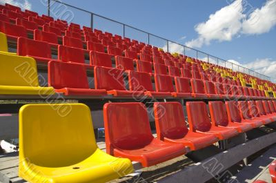 Lines of color seats.