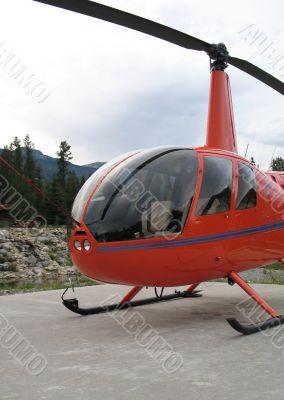 parked orange helicopter