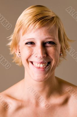 Blond girl with short hair making fun