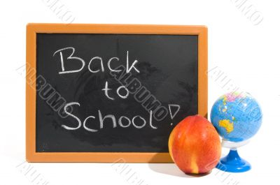 chalkboard with text back to school and apple and globe