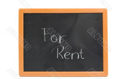 chalkboard with the text for rent