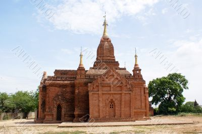 Brick temple with golden spire