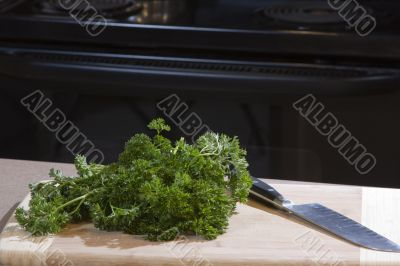 Food on a cutting board with chef`s knife