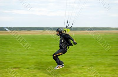 Landing of the sportsman after parachute jump