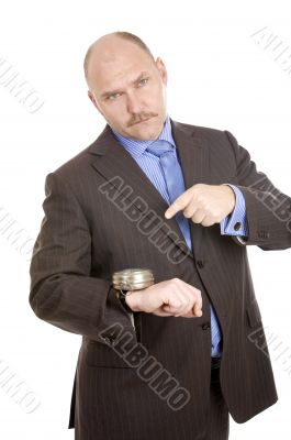 Pointing at his watch