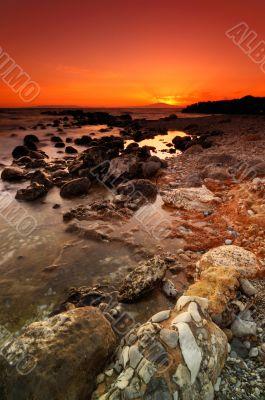 Rocky seascape sunset