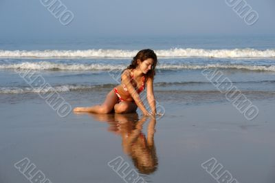 Beautiful girl on the ocean beach