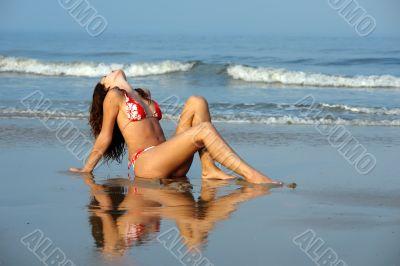 Beautiful girl relaxing on the ocean beach