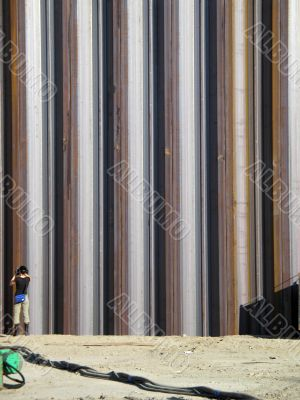 girl taking pictures of metal girders