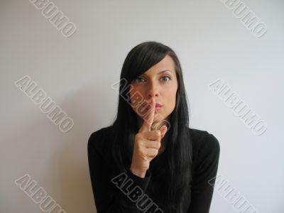 pretty girl asking for silence