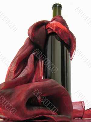Wine bottle and red scarf