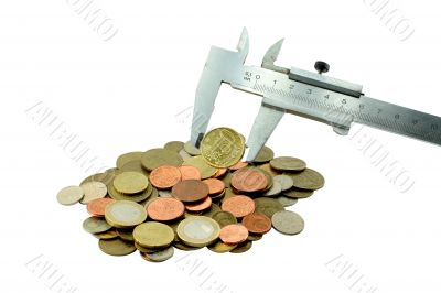 Coins and measuring tool