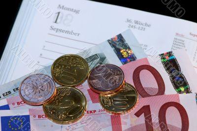 Money, Euros and calendars.