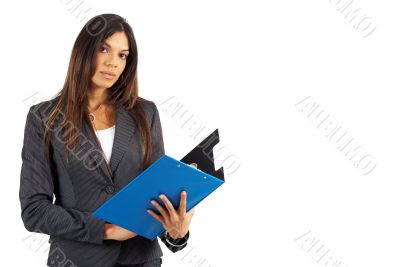 Beautiful brunette businesswoman holding clipboard