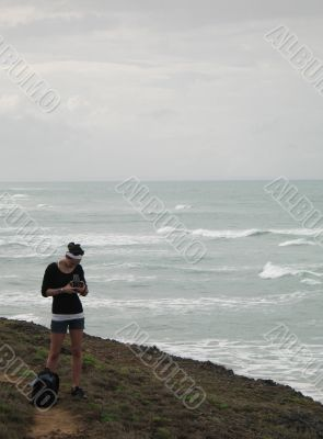 girl taking pictures on a cliff