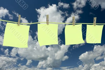 Four clean memo hanging on a cord. 3D image.