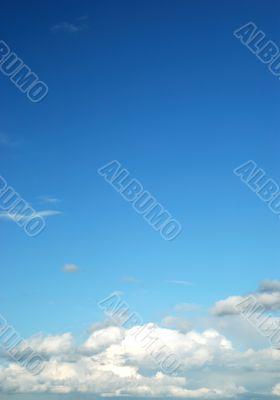 fluffy cloud on bright blue sky