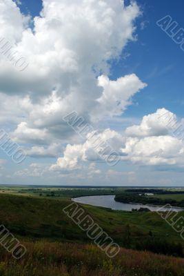 Cumulus clouds above the river