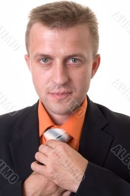 businessman with beard adjusting his tie