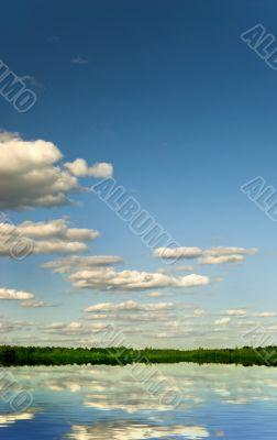 Cumulus clouds over lake