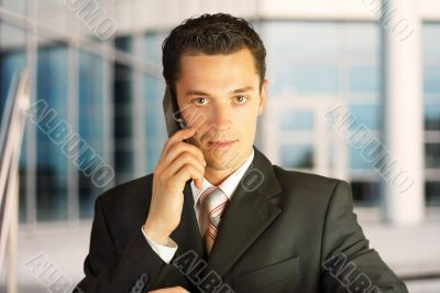 Businessman outside a modern building.