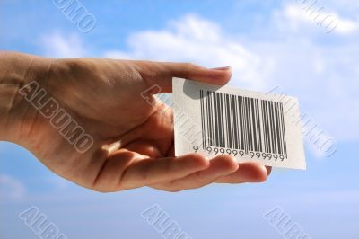 hand holding business card with fake bar code