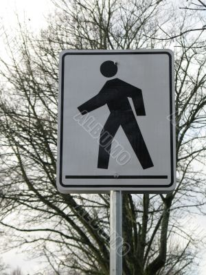 black and white pedestrian crossing sign