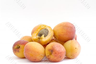Fresh appetizing apricots on a white background