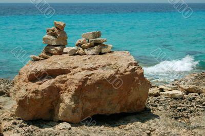 Pile of stones on sea