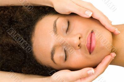 girl receiving head massage