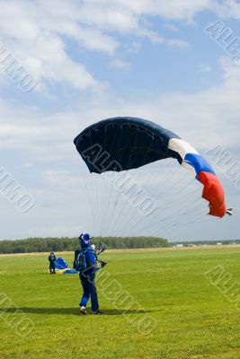 Landing of the sportsman after parachute jump