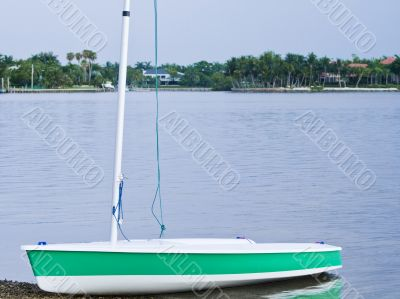 Sail boat on the shore